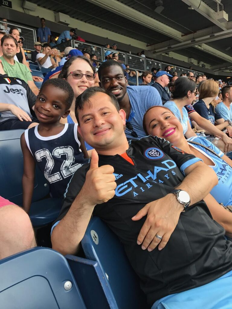 With friends at a soccer game