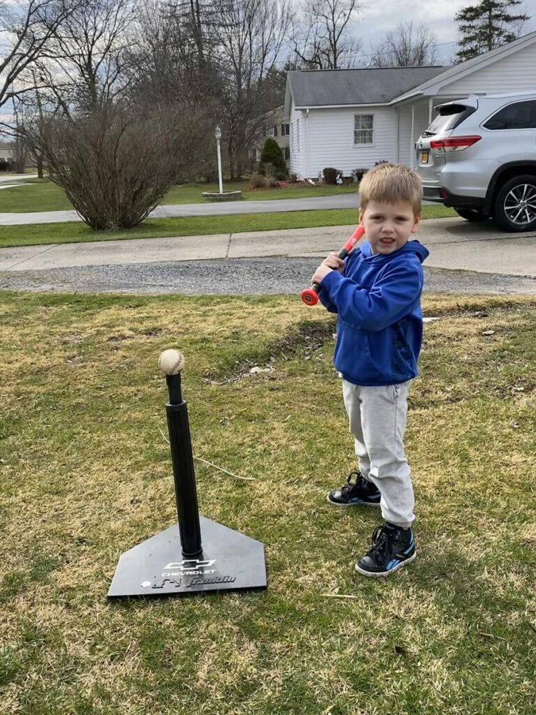 GAVIN PRACTICING HIS SWING IN OUR YARD