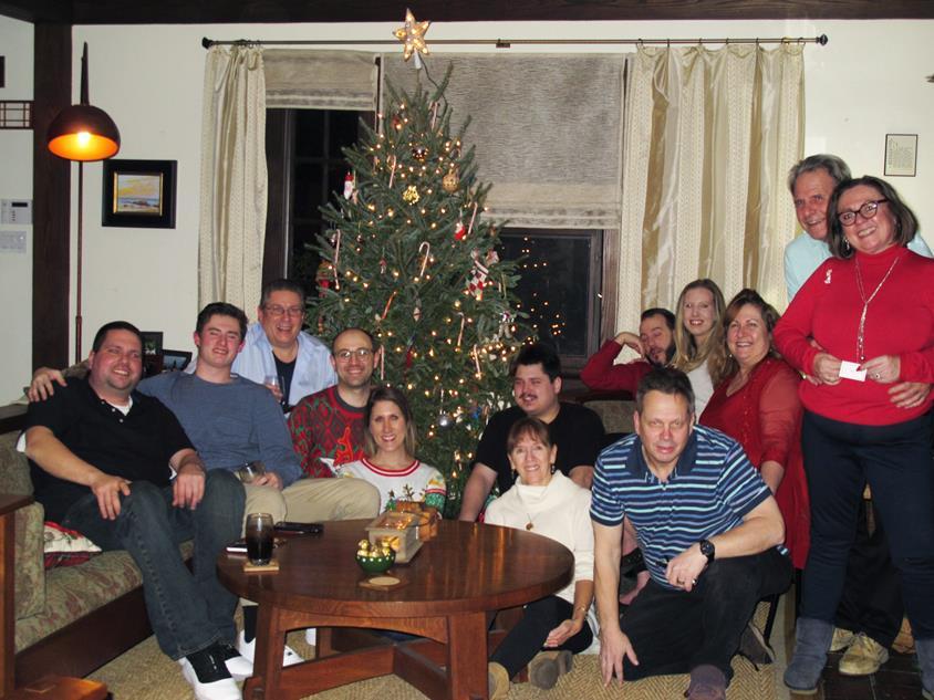 FAMILY GATHERED AROUND OUR CHRISTMAS TREE