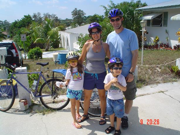 Joe bicycling with sister, niece, and nephew