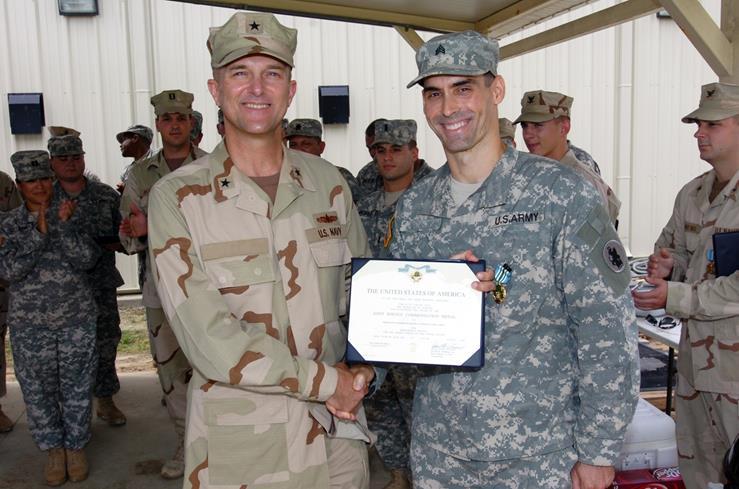 Joe receiving a military award