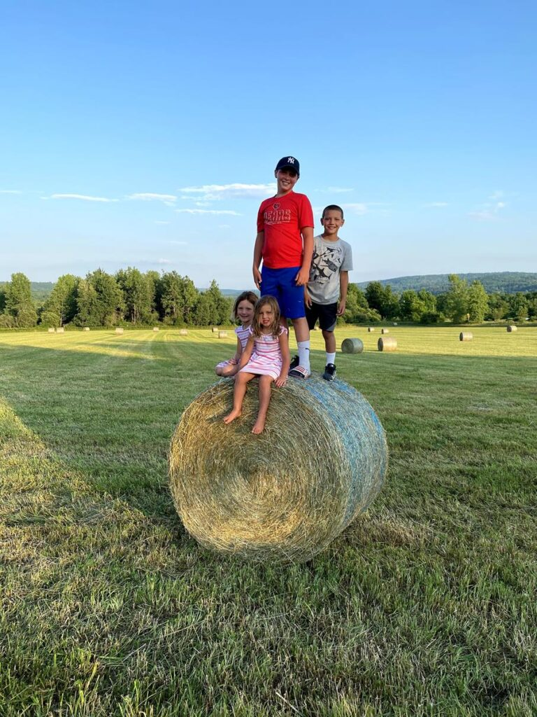 PLAYING ON HAY BALES