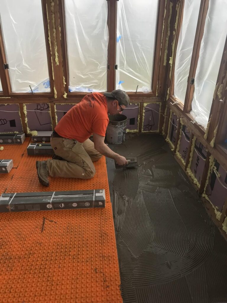 KEN PUTTING IN HEATED FLOORS FOR OUR HOUSE
